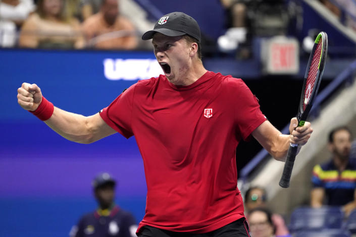 Jenson Brooksby, of the United States, reacts during his match against Novak Djokovic, of Serbia, during the fourth round of the U.S. Open tennis championships, Monday, Sept. 6, 2021, in New York. (AP Photo/John Minchillo)