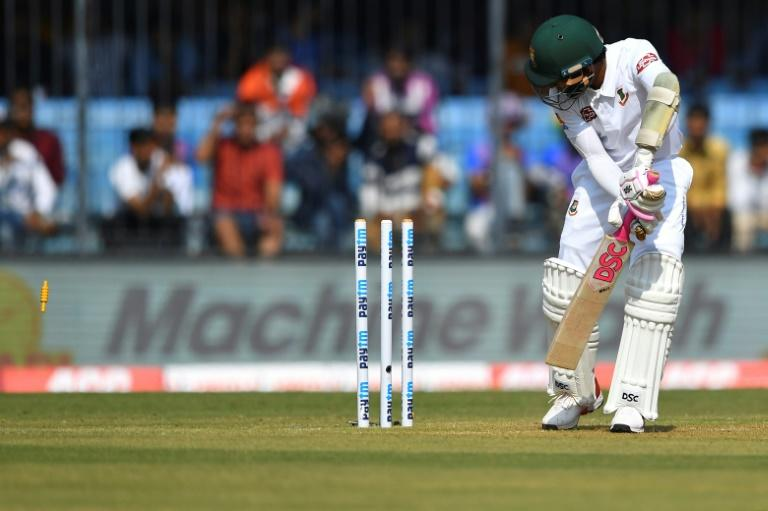 Bangladesh's Mushfiqur Rahim is clean bowled for 43 on the first day of the Test  match against India at Holkar Stadium in Indore