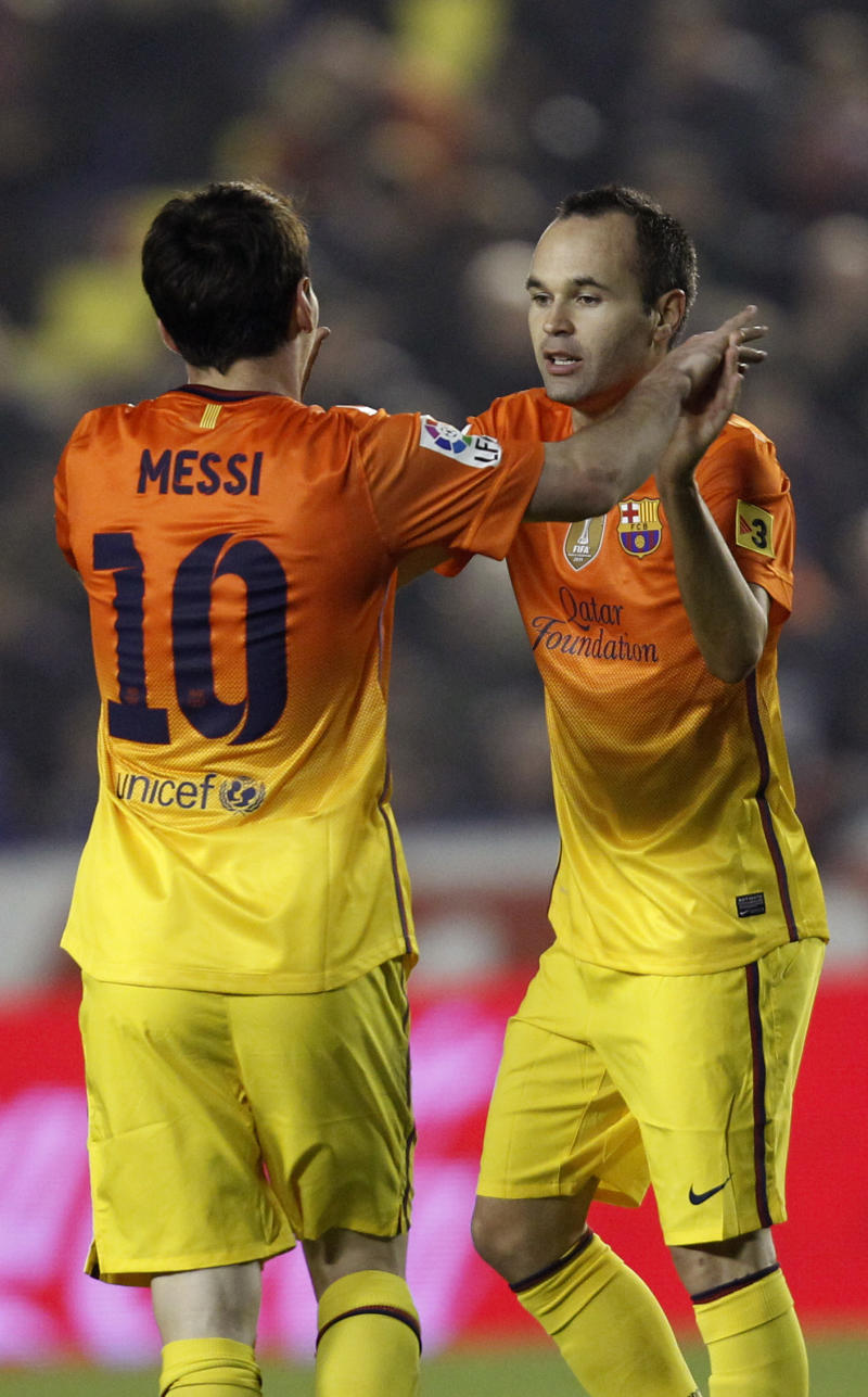 Barcelona's Lionel Messi from Argentina is congratulated by teammate Andres Iniesta, right,  after scoring a goal against Levante during their la liga soccer match at the Ciutat Valencia stadium in Valencia, Spain, Sunday, Nov. 25, 2012.(AP Photo/ Alberto Saiz)