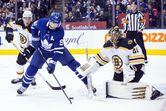Toronto Maple Leafs' John Tavares (91) tries to steer the puck past Boston Bruins goaltender Jaroslav Halak during second-period NHL hockey game action in Toronto, Monday, Nov. 26, 2018. (Chris Young/The Canadian Press via AP)