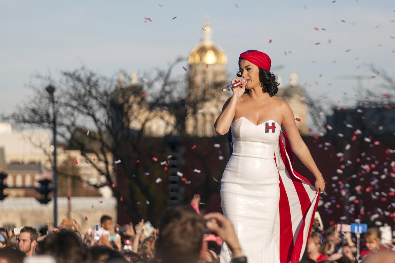 """<p>If judgement were to be passed on fashion alone, Katy Perry would win the title for biggest Hillary Clinton fan around. For a rally in Iowa, the singer performed on an outdoor stage to a large audience wearing a custom white gown covered in sequins with a Hillary 2016 logo on the chest. The dress featured an American flag attached to the back as a cape and she covered her hair in a blue and red turban. """"How many of you are going to be 18 next year, before November? Are you going to vote? Because you know you have the power, right?"""" Perry asked her fans in-between songs. """"Listen, you have so much power and this is going to be one of the most important elections in over a decade. <i>Photo: Reuters</i></p>"""