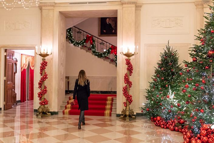First Lady Melania Trump reviews the Christmas decorations Sunday, Nov. 25, 2018, in the Cross Hall of the White House.