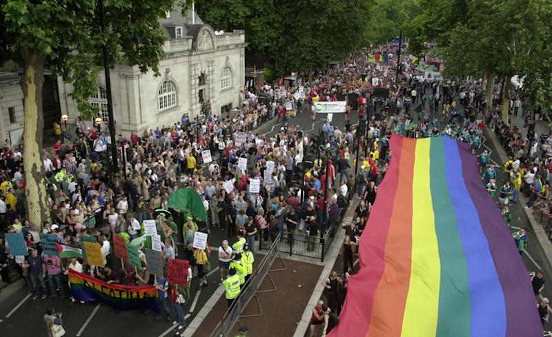 Revellers pass along the Victoria Embankment in central London, as the Gay Pride Mardi Gras 2003 parade begins. The parade passes through central London to Hyde Park where Pride in the Park is set to take place.