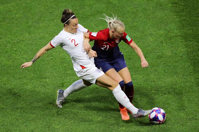 Karina Saevik of Norway is challenged by Lucy Bronze of England during the 2019 FIFA Women's World Cup France Quarter Final match between Norway and England at Stade Oceane on June 27, 2019 in Le Havre, France. (Photo by Elsa/Getty Images)