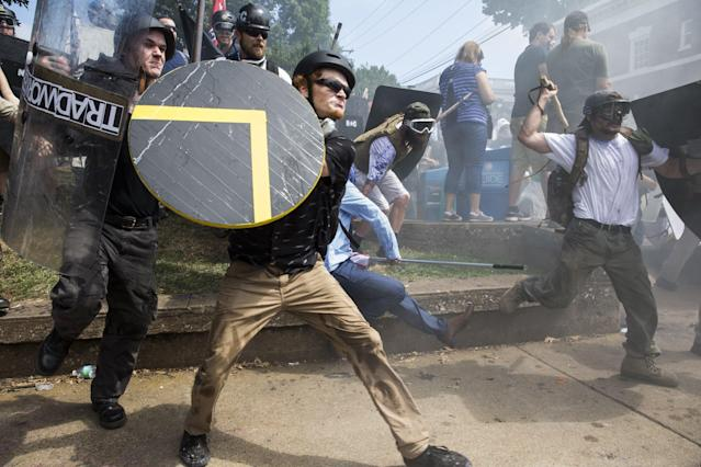 White supremacists rush forward with shields and sticks during clashes with counter-protesters at Emancipation Park in Charlottesville, Virginia, on Saturday. (Anadolu Agency via Getty Images)