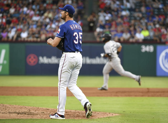 Texas Rangers starting pitcher Cole Hamels (35) walks back to the mound as New York Yankees' Gleyber Torres rounds the bases on a solo home run during the third inning of a baseball game Tuesday, May 22, 2018, in Arlington, Texas. (AP Photo/Jeffrey McWhorter)