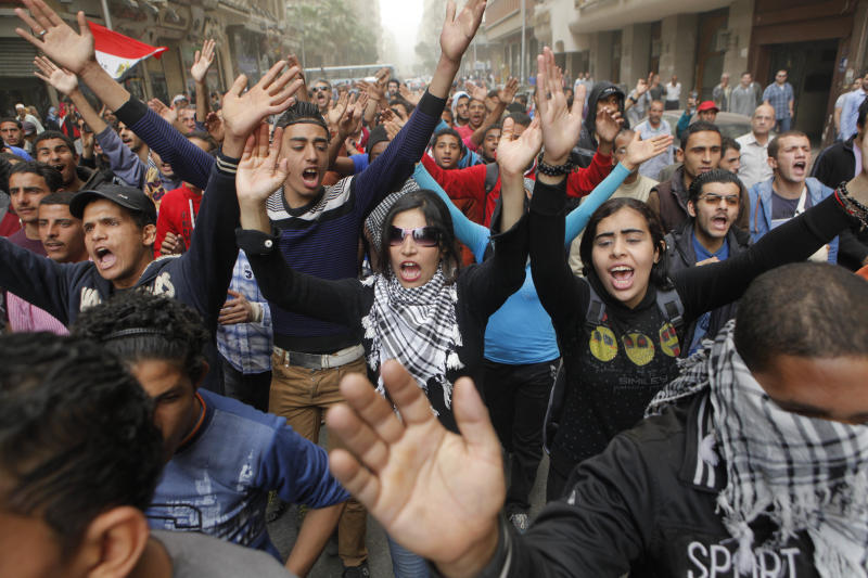 Egyptians shout anti-Muslim Brotherhood slogans during a march from downtown to the main Brotherhood headquarters in the hilltop neighborhood of Muqattam, Cairo, Egypt, Friday, March 22, 2013. Thousands of protesters from different areas of Cairo are marching on Friday to express their rejection of the Muslim Brotherhood and President Mohammed Morsi's rule. (AP Photo/Amr Nabil)
