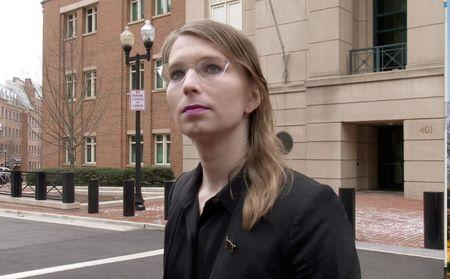 FILE PHOTO: FILE PHOTO: Chelsea Manning speaks to reporters outside the U.S. federal courthouse shortly before appearing before a federal judge and being taken into custody for contempt of court in Alexandria, Virginia