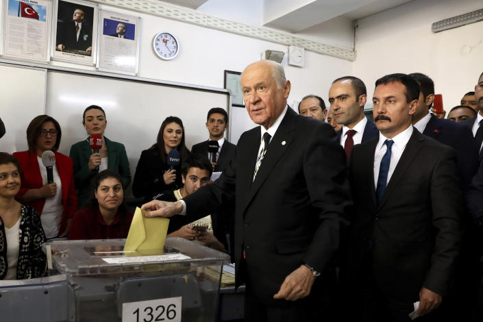 Chairman of the Nationalist Movement Party MHP Devlet Bahceli casts his ballot at a polling station in Ankara, Turkey, Sunday, March 31, 2019. Turkish citizens have begun casting votes in municipal elections for mayors, local assembly representatives and neighborhood or village administrators that are seen as a barometer of Erdogan's popularity amid a sharp economic downturn. (AP Photo/Ali Unal)