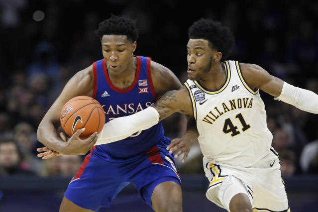 Villanova's Saddiq Bey, right, tries to knock the ball away from Kansas' David McCormack during the second half of an NCAA college basketball game, Saturday, Dec. 21, 2019, in Philadelphia. (AP Photo/Matt Slocum)