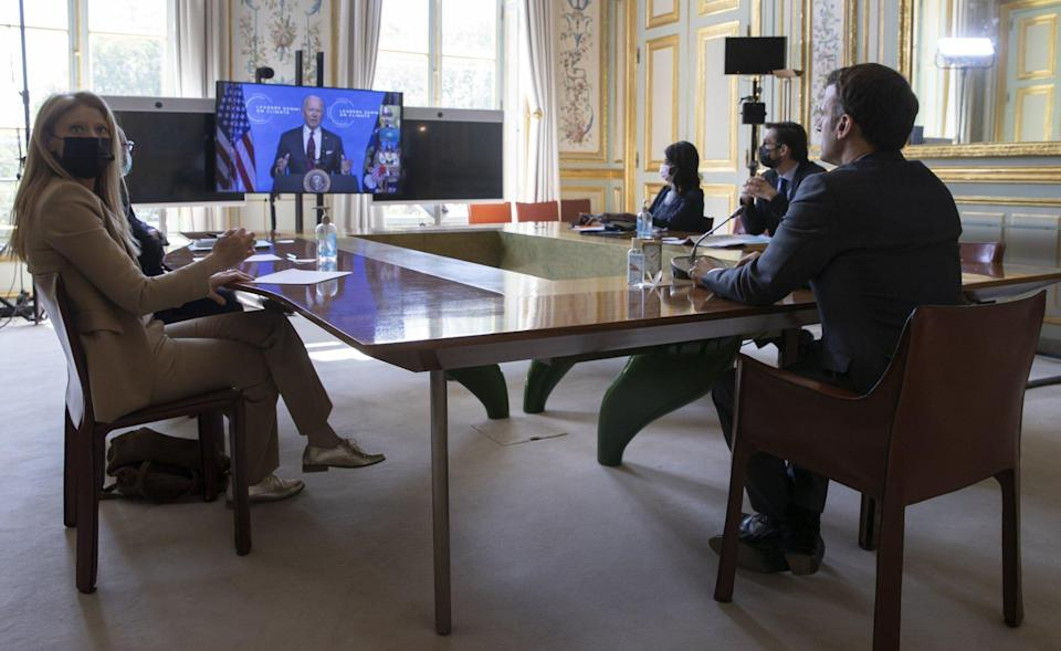 French President Emmanuel Macron listens to US President Joe Biden speaks during a climate summit video conference, at the Elysee Palace, in Paris, France on Thursday. Photo: AP