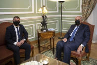 Egyptian Foreign Minister Sameh Shoukry meets with Israeli Foreign Minister Gabi Ashkenazi at the Tahrir Palace in Cairo, Egypt, Sunday, May 30, 2021. (AP Photo/Nariman El-Mofty)