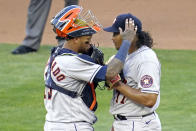 Houston Astros pitcher Luis Garcia, right, is consoled by catcher Martin Maldonado after giving up an RBI-double to Minnesota Twins' Miguel Sano in the fourth inning of a baseball game, Saturday, June 12, 2021, in Minneapolis. (AP Photo/Jim Mone)