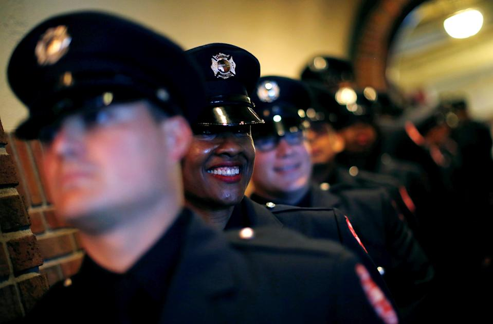 Chicago Fire department candidate firefighter Gwen Stevenson smiles as she waits for the start of her graduation ceremony in Chicago, Illinois, U.S. May 31, 2016.   REUTERS/Jim Young