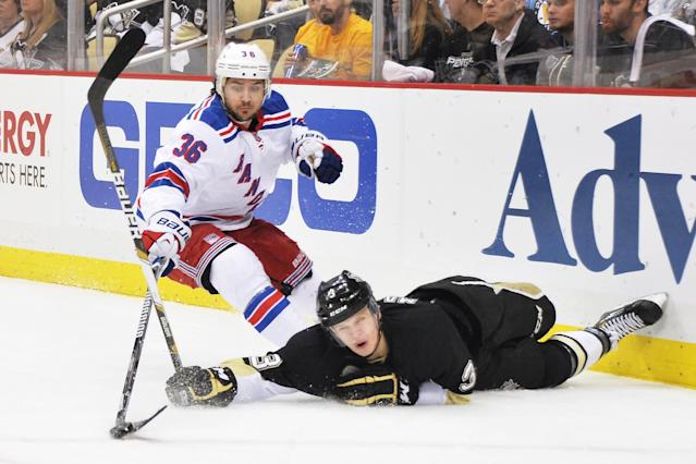 PITTSBURGH, PA - MAY 9: Olli Maatta #3 of the Pittsburgh Penguins reaches for the puck after falling to the ice as Mats Zuccarello #36 of the New York Rangers pokes the puck forward in the first period in Game Five of the Second Round of the 2014 NHL Stanley Cup Playoffs on May 9, 2014 at CONSOL Energy Center in Pittsburgh, Pennsylvania. (Photo by Jamie Sabau/Getty Images)