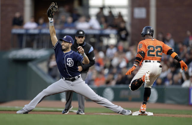 San Diego Padres first baseman Eric Hosmer, left, stretches to put out San Francisco Giants' Andrew McCutchen (22) at first base after a ground ball during the fourth inning of a baseball game Friday, June 22, 2018, in San Francisco. (AP Photo/Marcio Jose Sanchez)