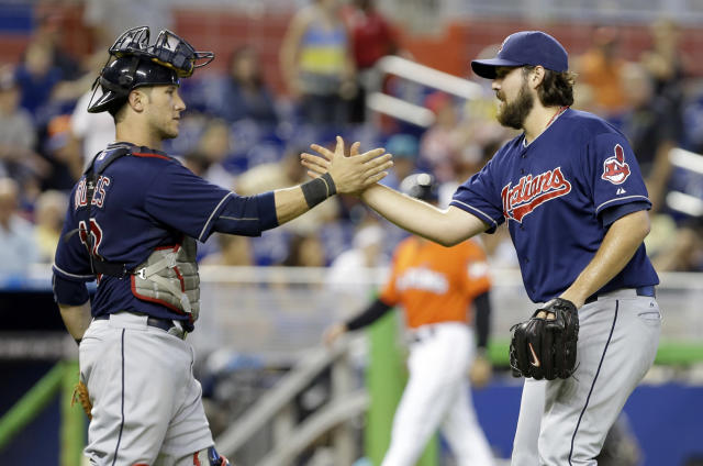 Cleveland Indians catcher Yan Gomes, left, and relief pitcher Chris Perez, right, shake hands after the Indians defeated the Miami Marlins 2-0 during an interleague baseball game, Sunday, Aug. 4, 2013, in Miami. (AP Photo/Lynne Sladky)