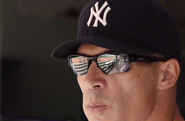 New York Yankees manager Joe Girardi looks on from the dugout before their baseball game against the Boston Red Sox at Fenway Park in Boston Saturday, Sept. 14, 2013. (AP Photo/Winslow Townson)