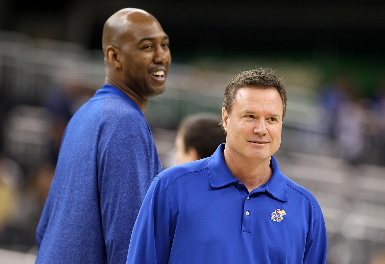 NEW ORLEANS, LA - MARCH 30:  (R-L) Head coach Bill Self of the Kansas Jayhawks stands in front of assistant coach Danny Manning during practice prior to the 2012 Final Four of the NCAA Division I Men's Basketball Tournament at the Mercedes-Benz Superdome on March 30, 2012 in New Orleans, Louisiana.  (Photo by Jeff Gross/Getty Images)