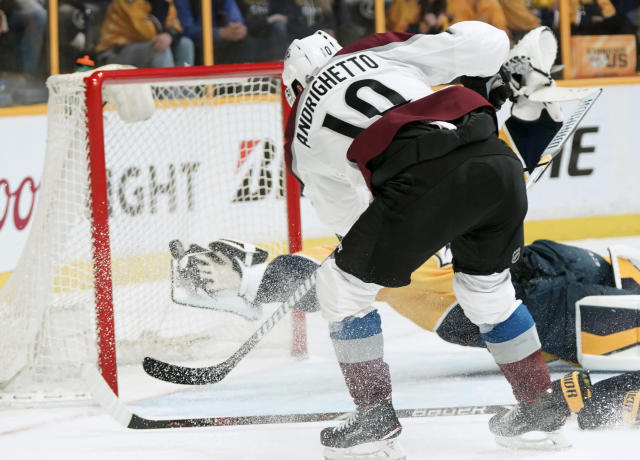 Colorado Avalanche right wing Sven Andrighetto (10), of Switzerland, fires a shot past the outstretched blocker hand of Nashville Predators goalie Pekka Rinne late in the third period in Game 5 of an NHL hockey first-round playoff series Friday, April 20, 2018, in Nashville, Tenn. The Avalanche won 2-1. (AP Photo/Sanford Myers)