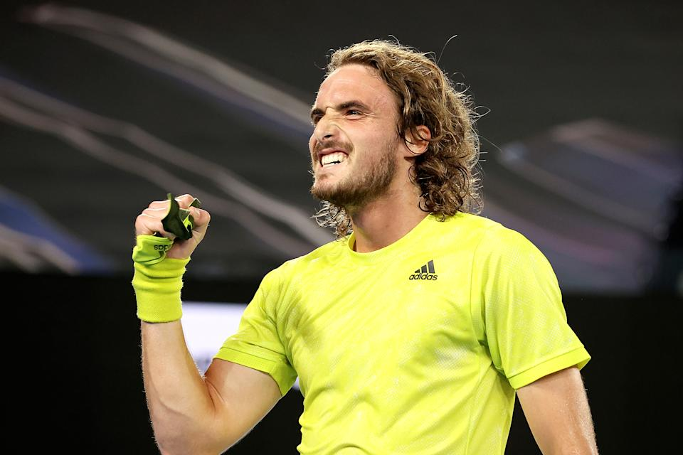 TOPSHOT - Greece's Stefanos Tsitsipas celebrates after winning against Spain's Rafael Nadal during their men's singles quarter-final match on day ten of the Australian Open tennis tournament in Melbourne on February 17, 2021. (Photo by DAVID GRAY / AFP) / -- IMAGE RESTRICTED TO EDITORIAL USE - STRICTLY NO COMMERCIAL USE -- (Photo by DAVID GRAY/AFP via Getty Images)