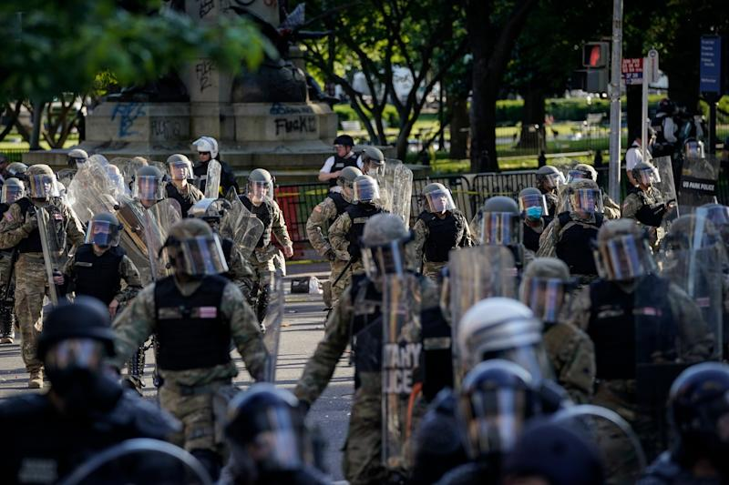 Law enforcement officers mobilizes to clear the path of protesters for Donald Trump's photo-op with a Bible on June 1. (Drew Angerer via Getty Images)