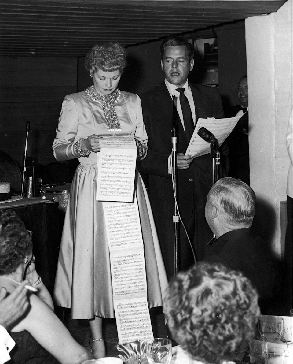 <p>The husband and wife power duo behind <em>I Love Lucy,</em> Lucille Ball and Desi Arnaz, perform a comedic set at the City of Hope Benefit held inside the Racquet Club. </p>