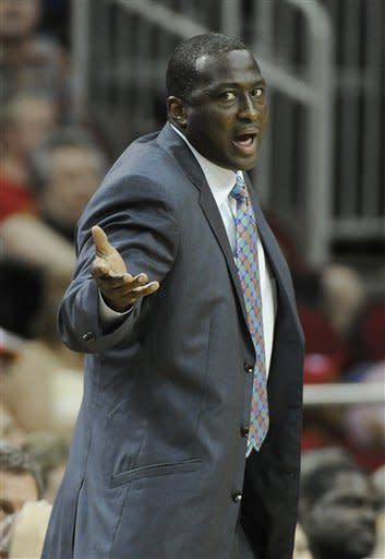 Utah Jazz coach Tyrone Corbin disagrees with a referee's call in the first half of an NBA basketball game against the Houston Rockets on Wednesday, April 11, 2012, in Houston. (AP Photo/Pat Sullivan)