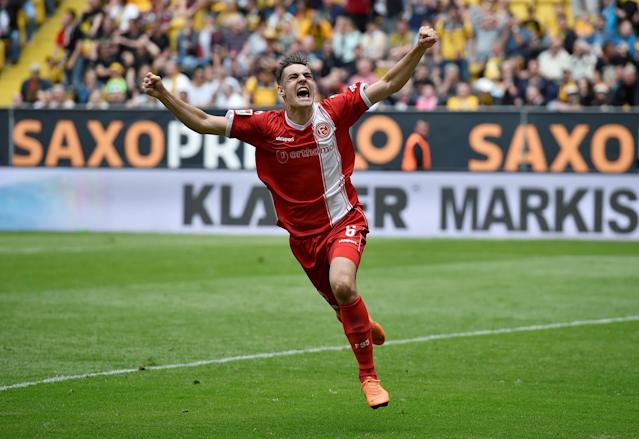 Soccer Football - 2. Bundesliga - Dynamo Dresden v Fortuna Dusseldorf - DDV-Stadion, Dresden, Germany - April 28, 2018 Fortuna Dusseldorf's Florian Neuhaus celebrates REUTERS/Matthias Rietschel DFL RULES TO LIMIT THE ONLINE USAGE DURING MATCH TIME TO 15 PICTURES PER GAME. IMAGE SEQUENCES TO SIMULATE VIDEO IS NOT ALLOWED AT ANY TIME. FOR FURTHER QUERIES PLEASE CONTACT DFL DIRECTLY AT + 49 69 650050