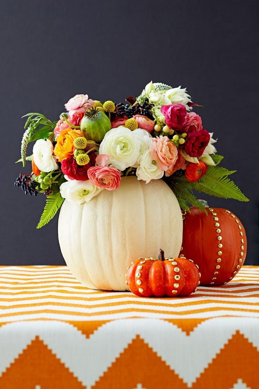 <p>Rather than settle for a traditional vase, make one out of a basic gourd. Try enhancing it with gold studs for a trendy look. <br></p>