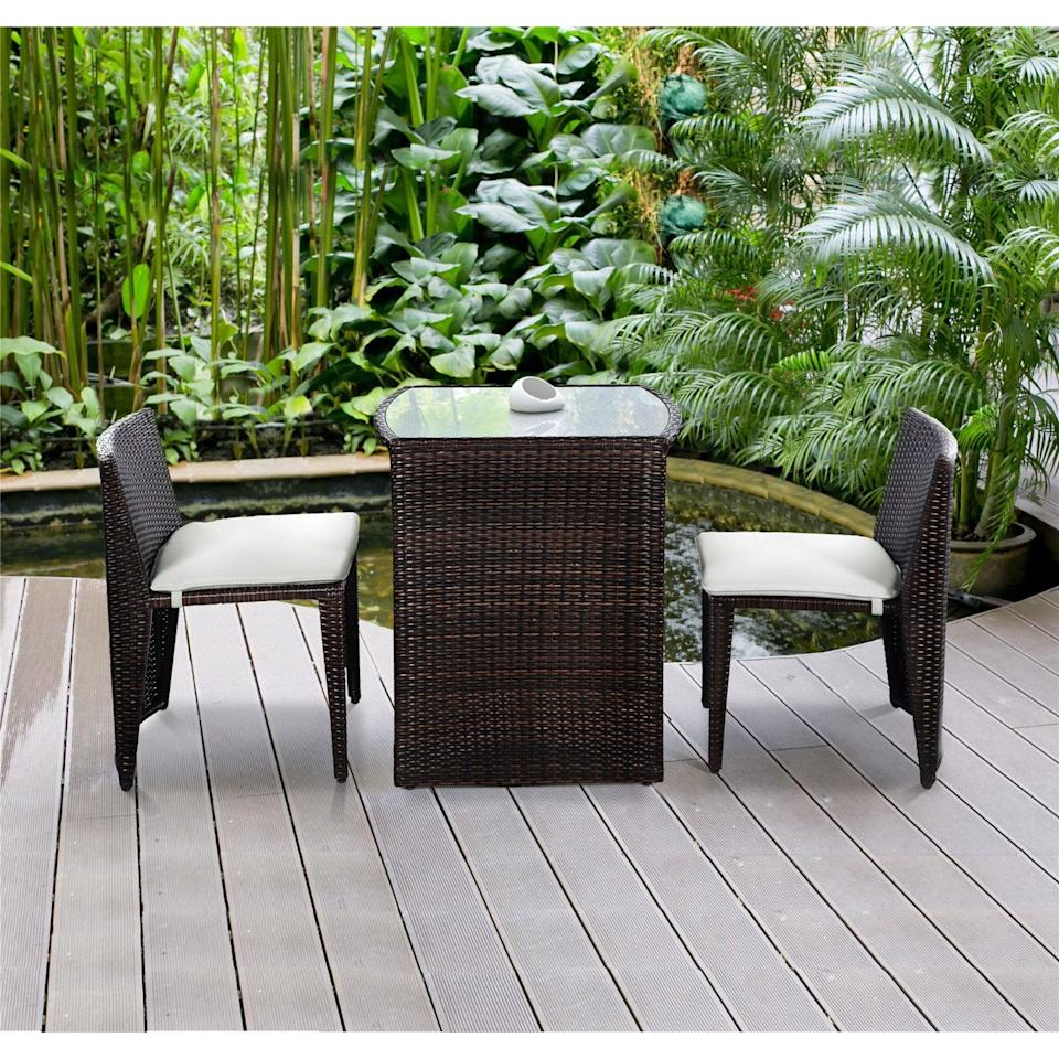 <p>The chairs on this <span>Costway Wicker 3-Piece Small Space Outdoor Bistro Set With Cushions</span> ($200, originally $299) can be tucked underneath the table, making for an efficient solution to a small-space problem.</p>