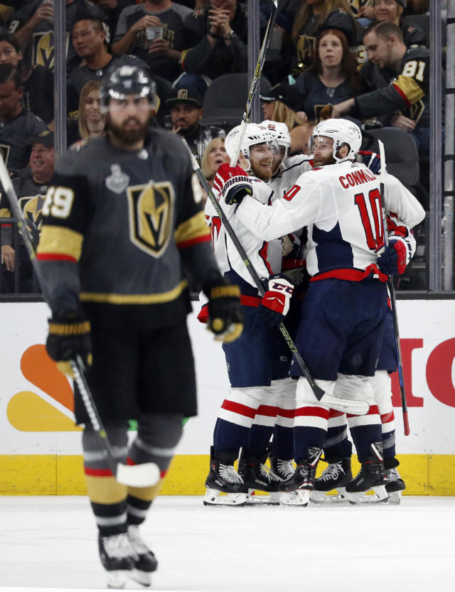 Washington Capitals, right, celebrate a goal by defenseman Brooks Orpik as Vegas Golden Knights right wing Alex Tuch skates away during the second period in Game 2 of the NHL hockey Stanley Cup Finals on Wednesday, May 30, 2018, in Las Vegas. (AP Photo/John Locher)