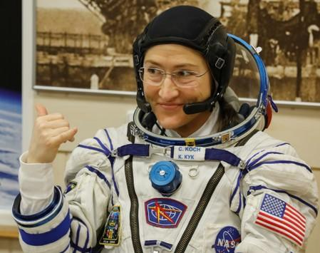 FILE PHOTO: The International Space Station (ISS) crew member Christina Koch of the U.S. gestures after donning space suits shortly before their launch at the Baikonur Cosmodrome