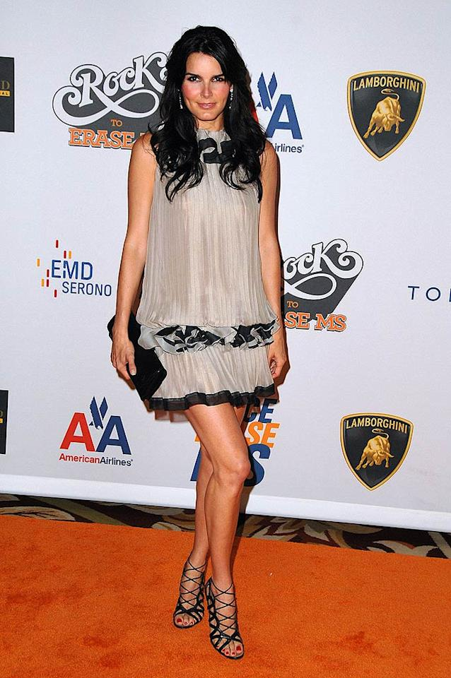 """Angie Harmon advertised her glorious gams at a recent star-studded soiree in a black and taupe sleeveless Moschino mini paired with seductive strappy heels. Steve Granitz/<a href=""""http://www.wireimage.com"""" target=""""new"""">WireImage.com</a> - May 8, 2009"""