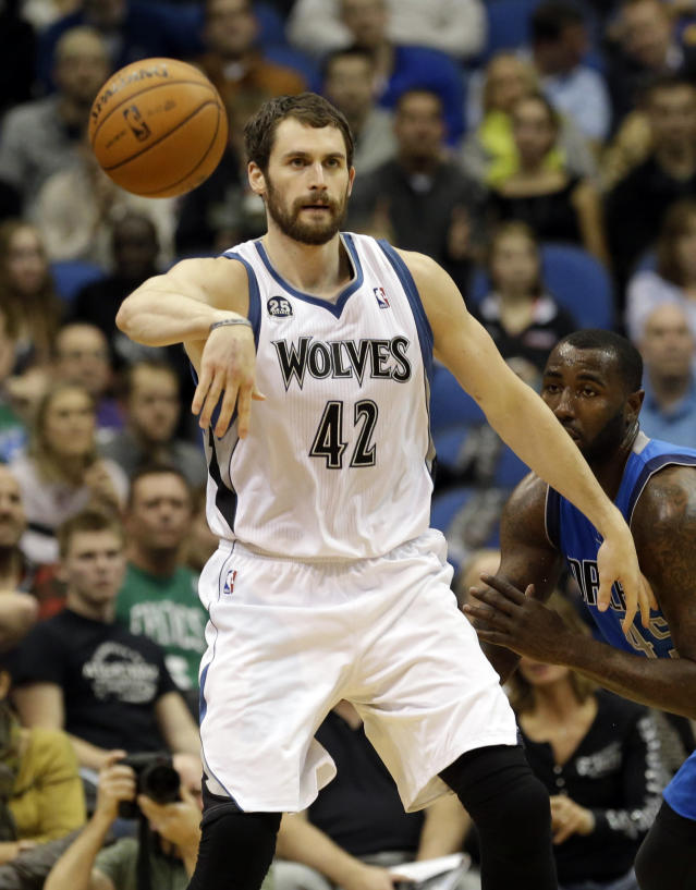 In this photo taken on Friday, Nov. 8, 2103, Minnesota Timberwolves' Kevin Love passes the ball during an NBA basketball game against the Dallas Mavericks. Love has often been criticized for being more concerned about racking up stats than making his teammates better, but he took that criticism to heart and has taken his game and team to another level this season, averaging a career-high 5.0 assists per game.(AP Photo/Jim Mone)