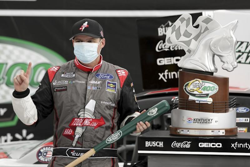 Cole Custer celebrates with the trophy after winning a NASCAR Cup Series auto race Sunday, July 12, 2020, in Sparta, Ky. (AP Photo/Mark Humphrey)