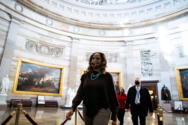 Impeachment manager Representative Stacey Plaskett (D-US Virgin Islands AT-Large) walks through the Rotunda of the U.S. Capitol