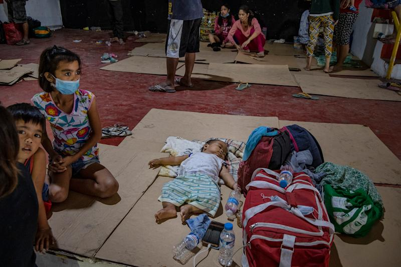 Residents who fled Taal's eruption at an evacuation center in Santo Thomas on Jan. 13. | Ezra Acayan—Getty Images