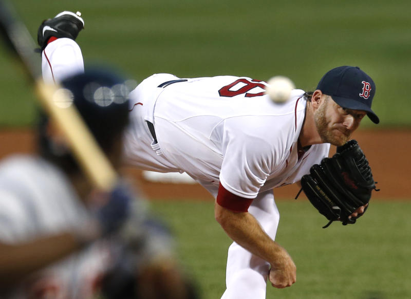 Boston Red Sox starting pitcher Ryan Dempster fires one in against the Detroit Tigers during the first inning of a baseball game at Fenway Park in Boston, Wednesday, Sept. 4, 2013. (AP Photo/Elise Amendola)