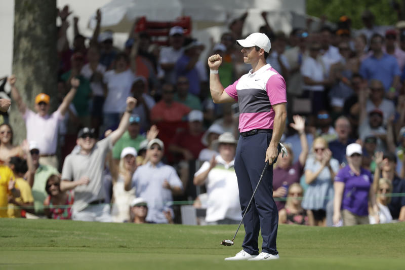 Rory McIlroy, of Northern Ireland, celebrates after sinking his birdie putt on the 18th green to give him the lead during the third round of the World Golf Championships-FedEx St. Jude Invitational Saturday, July 27, 2019, in Memphis, Tenn. McIlroy finished the day at 12-under par, one stroke ahead of Brooks Kopeka. (AP Photo/Mark Humphrey)