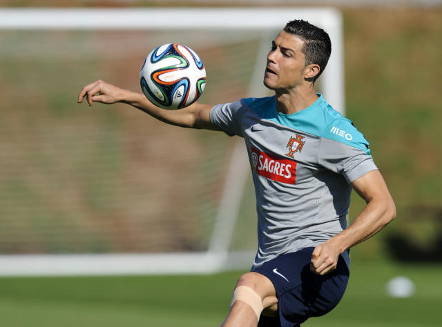 Cristiano Ronaldo controls the ball during a training session of Portugal in Campinas, Brazil, Friday, June 20, 2014. Portugal plays in group G of the Brazil 2014 soccer World Cup. (AP Photo/Paulo Duarte)