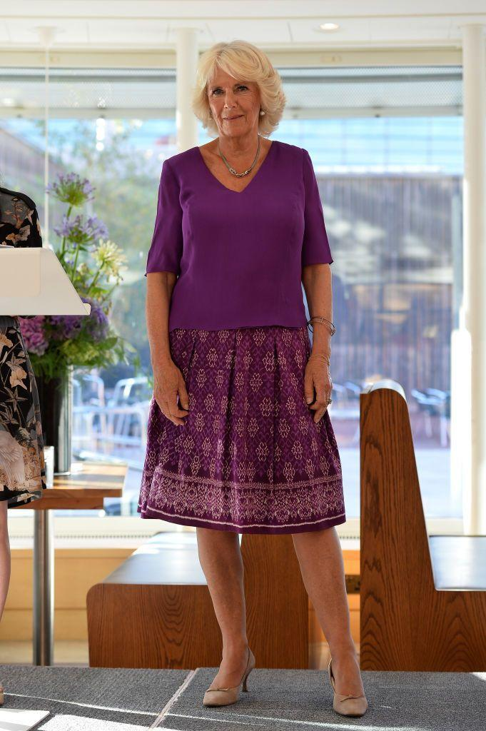 """<p>The Duchess of Cornwall wore a purple patterned skirt and matching top while speaking at <a href=""""https://rsliterature.org/"""" rel=""""nofollow noopener"""" target=""""_blank"""" data-ylk=""""slk:The Royal Society of Literature's"""" class=""""link rapid-noclick-resp"""">The Royal Society of Literature's</a> """"40 Under 40"""" fellow induction at The British Library.</p>"""