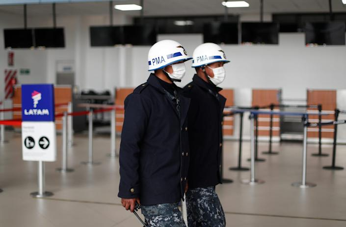 Military Police patrol inside El Alto airport wearing face masks, in Bolivia, Wednesday, Feb. 26, 2020.  2