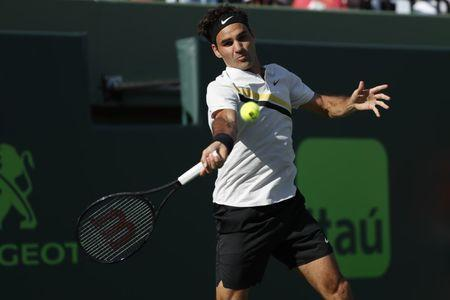 Mar 24, 2018; Key Biscayne, FL, USA; Roger Federer of Switzerland hits a forehand against Thanasi Kokkinakis of Australia (not pictured) on day five of the Miami Open at Tennis Center at Crandon Park. Kokkinakis won 3-6, 6-3, 7-6(4). Mandatory Credit: Geoff Burke-USA TODAY Sports