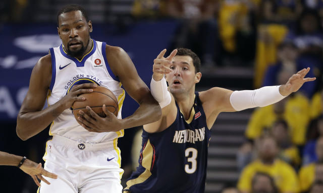 Golden State Warriors' Kevin Durant, left, is defended by New Orleans Pelicans' Nikola Mirotic during the first half in Game 5 of an NBA basketball second-round playoff series Tuesday, May 8, 2018, in Oakland, Calif. (AP Photo/Marcio Jose Sanchez)