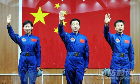 The crew of China's Shenzhou-9 mission, set to launch in June 2012, waves. L to R, Liu Yang (China's first female astronaut), Jing Haipeng, Liu Wang.