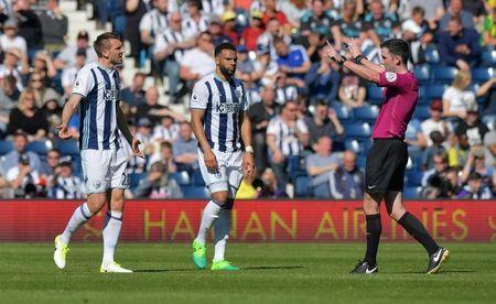 Britain Football Soccer - West Bromwich Albion v Southampton - Premier League - The Hawthorns - 8/4/17 West Bromwich Albion's Gareth McAuley and Matt Phillips look dejected as referee Chris Kavanagh gestures Reuters / Anthony Devlin Livepic