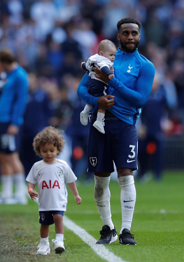 "Soccer Football - Premier League - Tottenham Hotspur vs Leicester City - Wembley Stadium, London, Britain - May 13, 2018 Tottenham's Danny Rose with children during a lap of honour after the match Action Images via Reuters/Andrew Couldridge EDITORIAL USE ONLY. No use with unauthorized audio, video, data, fixture lists, club/league logos or ""live"" services. Online in-match use limited to 75 images, no video emulation. No use in betting, games or single club/league/player publications. Please contact your account representative for further details."