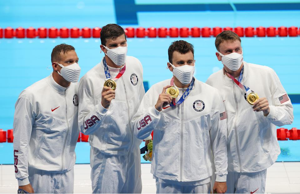 TOKYO, JAPAN - JULY 26: Caeleb Dressel, Zach Apple, Blake Pieroni, Bowen Becker of Team United States pose with their gold medals for the Men's 4 x 100m Freestyle Relay Final on day three of the Tokyo 2020 Olympic Games at Tokyo Aquatics Centre on July 26, 2021 in Tokyo, Japan. (Photo by Al Bello/Getty Images)