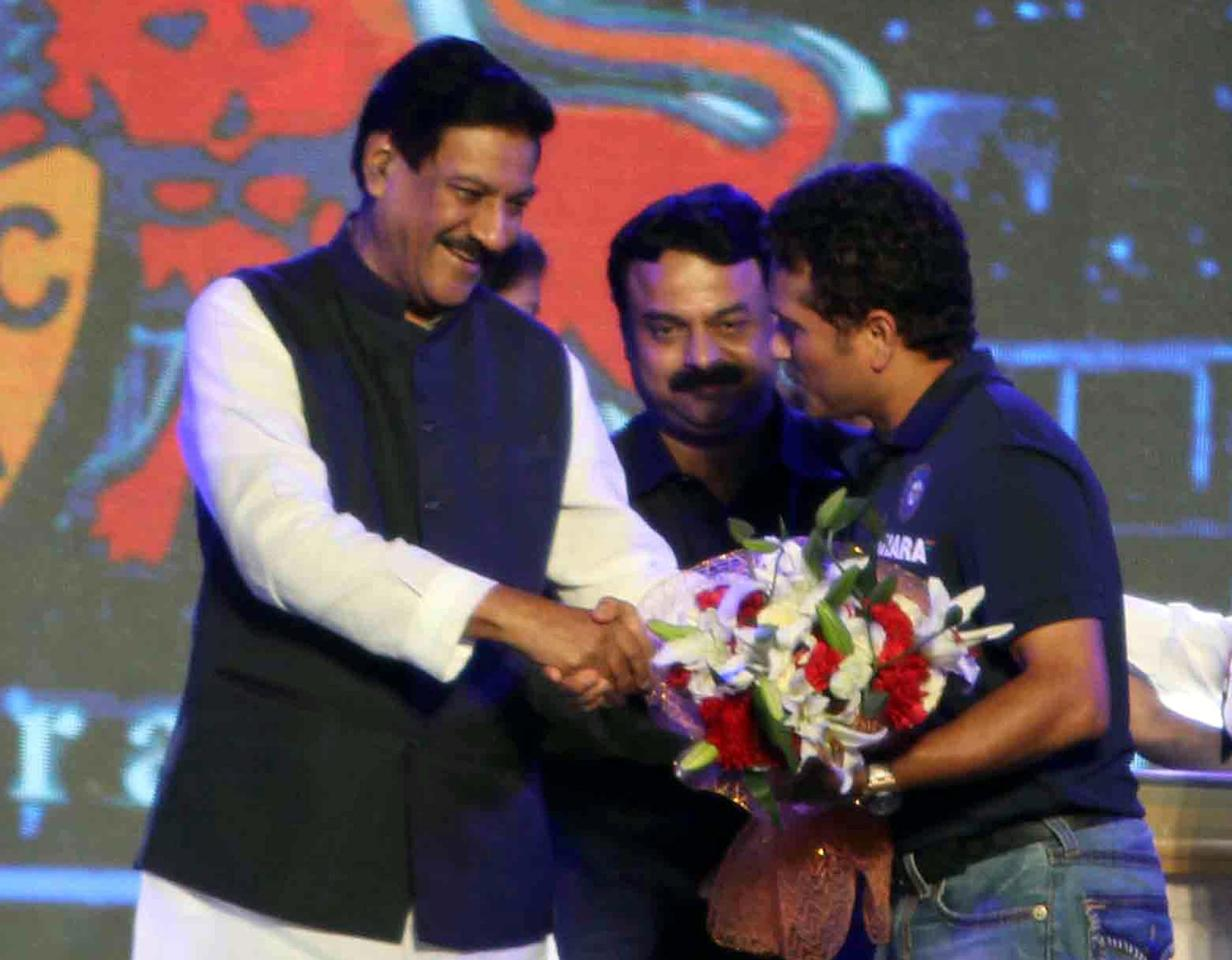 Maharashtra Chief Minister Prithviraj Chavan felicitates Indian cricketer Sachin Tendulkar during the rechristening ceremony of MCA sport complex at Kandivali West Mahavir Nagar as `Sachin Tendulkar Gymkhana` in Mumbai on Nov.11, 2013. Mumbai Mayor Sunil Prabhu is also present. (Photo: Sandeep Mahankaal/IANS)